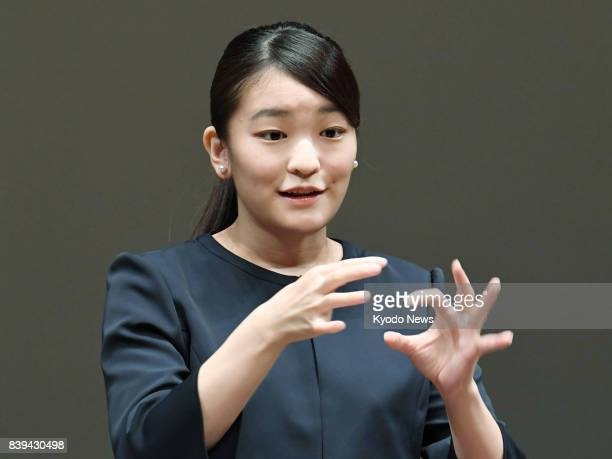 Princess Mako the eldest granddaughter of Emperor Akihito and Empress Michiko signs an address during a high school sign language contest in Tokyo on...