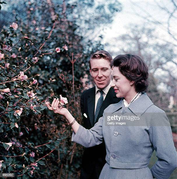 Princess Margaret and Antony ArmstrongJones stand February 27 1960 in the grounds of Royal Lodge on the day they announced their engagement...