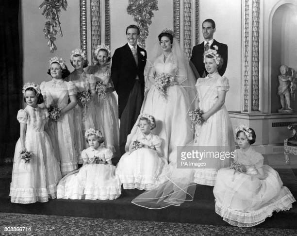 Princess Margaret and her bridegroom Antony ArmstrongJones pose with the rest of their wedding party at Buckingham Palace after their marriage...