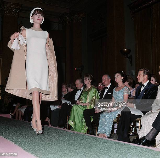 Princess Margaret and her husband Lord Snowdon watch a catwalk fashion show of the Balmain Collection in Paris
