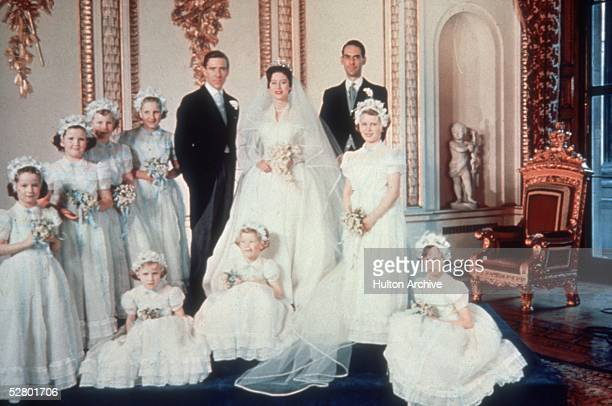 Princess Margaret and her new husband Antony Armstrong Jones pose for a picture with their bridesmaids at Buckingham Palace, 6th May 1960.