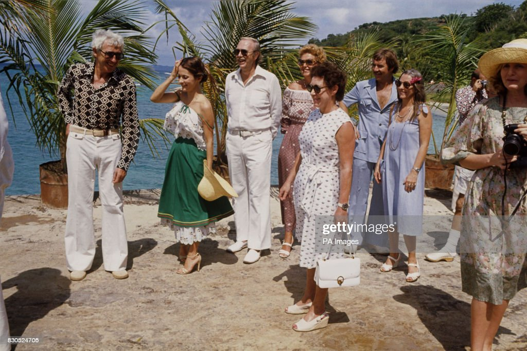 Princess Margaret Holding Handbag And Island Residents Waiting To Greet The Queen On Mustique