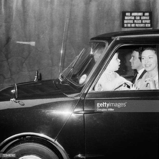 Princess Margaret and Lord Snowdon leave Great Ormond Street children's hospital, London with their three year-old son Viscount Linley, who has just...