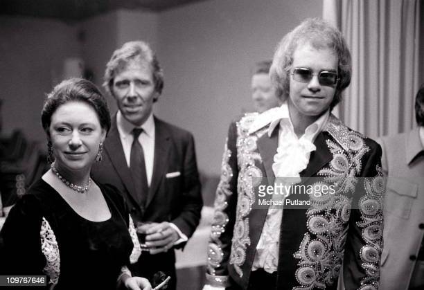 Princess Margaret and Lord Snowdon meet singer Elton John backstage at a benefit concert held at the Shaw Theatre in London England on February 27...