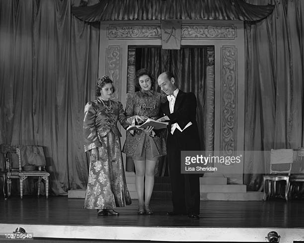 Princess Margaret and Princess Elizabeth both in costume go through their lines ahead of a royal pantomime production of 'Aladdin' at Windsor Castle...