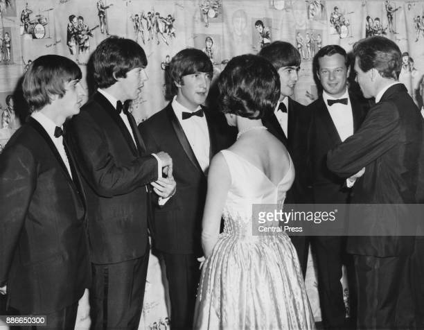 Princess Margaret and the Earl of Snowdon meet British rock group the Beatles at the world premiere of their film 'A Hard Day's Night' at the London...