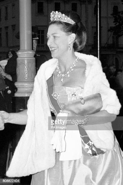 Princess Margaret arrives at The Embassy in Belgrave Square London to attend the dinner given by Austria's President Franz Jonas Her dress is...