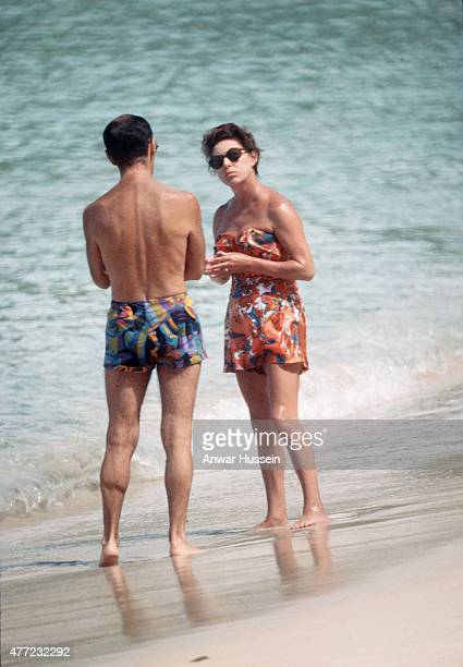 Princess Margaret chats to a friend on the beach whilst on holiday on February 01 1976 in Mustique West Indies