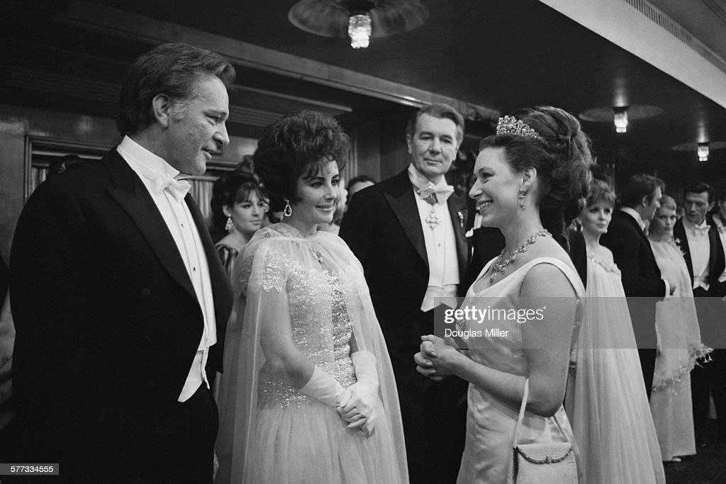 Princess Margaret (1930 - 2002, right) chatting to Richard Burton (1925 - 1984) and his wife Elizabeth Taylor (1932 - 2011) at the Royal Film Performance of 'The Taming Of The Shrew', which stars Taylor and Burton, at the Odeon Theatre, Leicester Square, London, 27th February 1967. Behind them is actor Sir Michael Redgrave (centre, right).