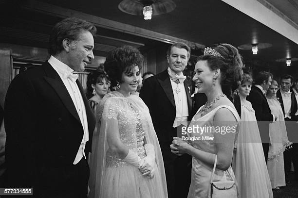 Princess Margaret chatting to Richard Burton and his wife Elizabeth Taylor at the Royal Film Performance of 'The Taming Of The Shrew', which stars...