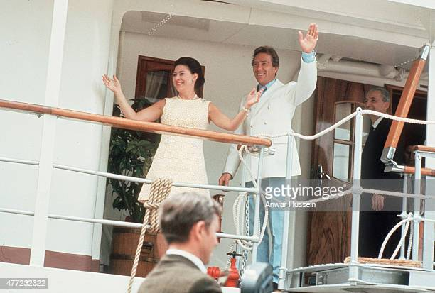 Princess Margaret and husband Tony ArmstrongJones wave from the deck on the Royal Yacht Britannia during their 6week Caribbean honeymoon cruise on...