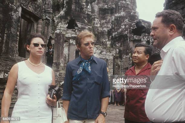 Princess Margaret, Countess of Snowdon and her husband Antony Armstrong-Jones pictured with Norodom Sihanouk , 2nd from right, during a visit to the...
