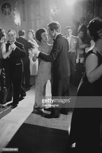 Princess Margaret Countess of Snowdon dancing with her husband Antony ArmstrongJones 1st Earl of Snowdon at a formal event UK 19th November 1963