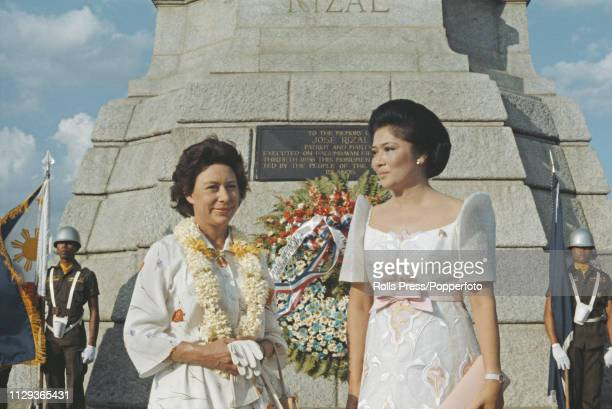 Princess Margaret Countess of Snowdon pictured on left with First Lady of the Philippines Imelda Marcos in front of the Rizal Monument in Rizal Park...