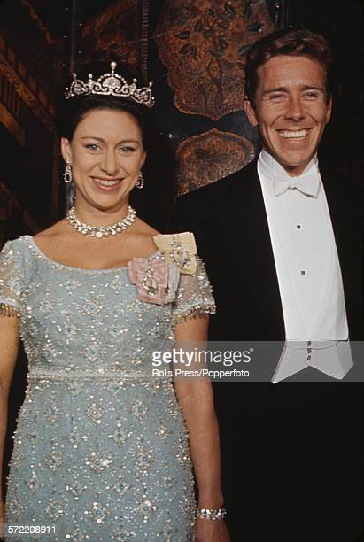 Princess Margaret Countess of Snowdon pictured wearing a tiara and ornate necklace with her husband Antony ArmstrongJones 1st Earl of Snowdon at an...