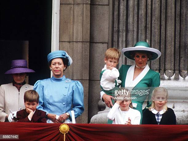 Princess Margaret, Countess of Snowdon, Prince William, Lady Rose Windsor, Diana, Princess of Wales, wearing a green dress with a white collar and...