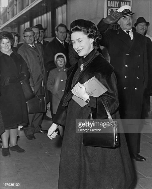 Princess Margaret Countess of Snowdon receives a salute from a commissionaire as she leaves the Ideal Home Exhibition at Olympia exhibition centre in...