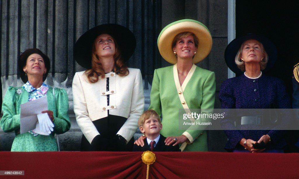 Princess Margaret, Sarah, Duchess of York, Prince Harry, Diana, Princess of Wales and the Duchess of Kent stand on the balcony of Buckingham Palace to watch The Battle of Britain Anniversary Parade on September 15, 1990 in London, England.