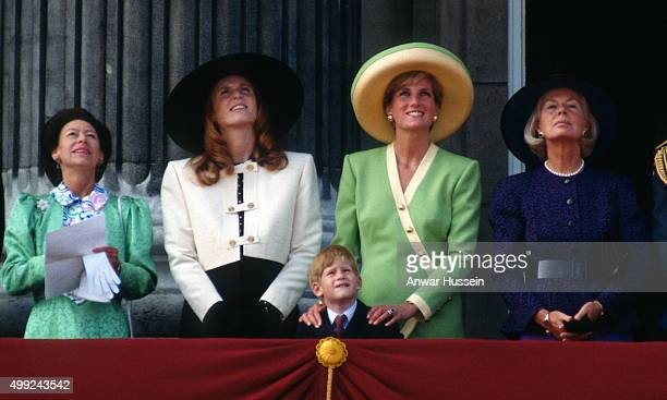 Princess Margaret Sarah Duchess of York Prince Harry Diana Princess of Wales and the Duchess of Kent stand on the balcony of Buckingham Palace to...