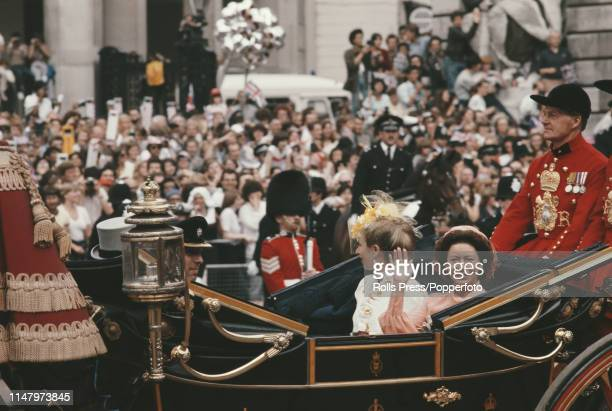 Princess Margaret, Countess of Snowdon waves to spectators lining the street as she rides with Princess Anne to St Paul's Cathedral for the royal...