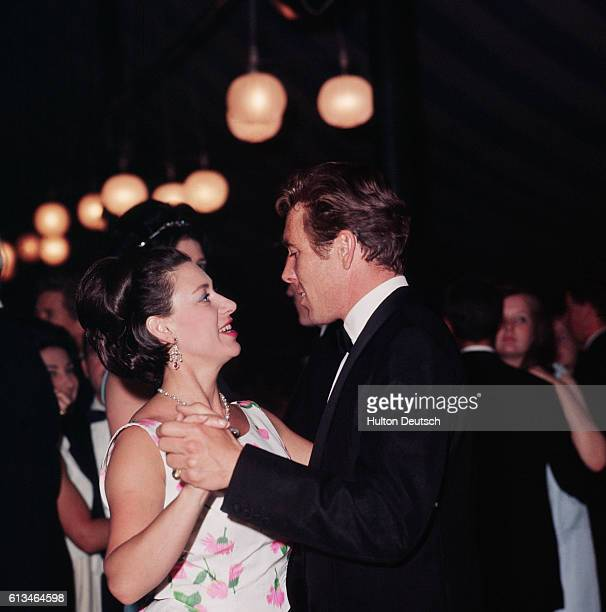 Princess Margaret dances with Lord Snowdon at a ball in aid of Barnardo's at the Tower of London