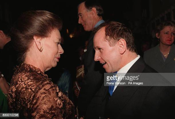 Princess Margaret greets Wayne Sleep at a reception for the Arts at Windsor Castle tonight Looking on are actor Michael Caine and actress Joan Collins