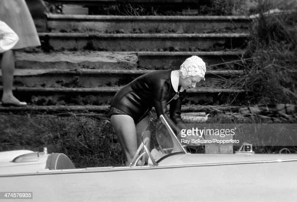Princess Margaret in a wetsuit tying a motorboat to the dock at Sunninghill Park Windsor on 25th July 1964 This image is one of a series taken by Ray...