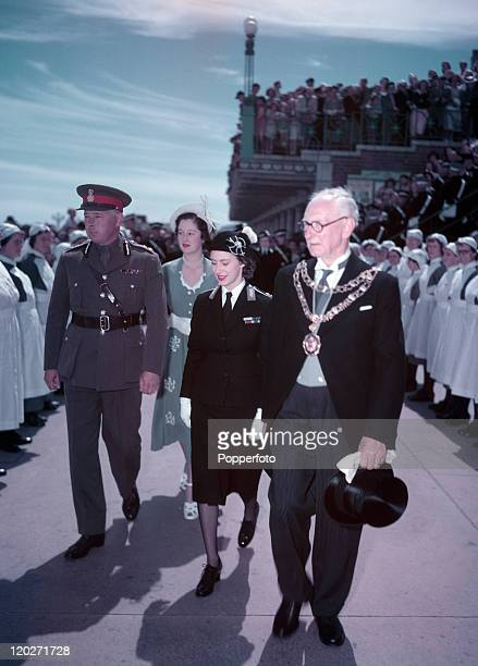 Princess Margaret insspecting nurses with the Duke of Norfolk in Arundel circa July 1949