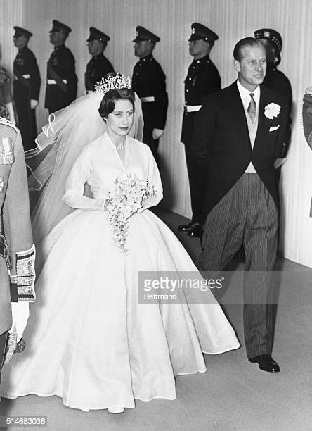 Princess Margaret is accompanied by her brotherinlaw Prince Philip during her wedding to Antony ArmstrongJones at Westminister Abbey