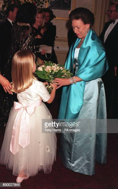 Princess Margaret is presented with a bouquet by fiveyearold dancer Nastassia Adkins at the Gala Performance of the English National Ballet's...