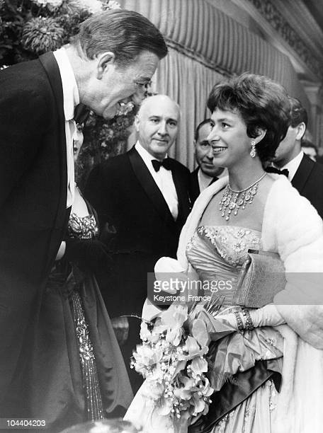 Princess MARGARET is talking with the American actor John WAYNE on the opening of the film ALAMO in London Astoria cinema