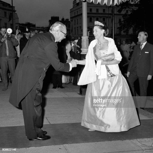 Princess Margaret is welcomed by Austrian Ambassador Dr Josef Schoner when she arrives at The Embassy in Belgrave Square London to attend the dinner...