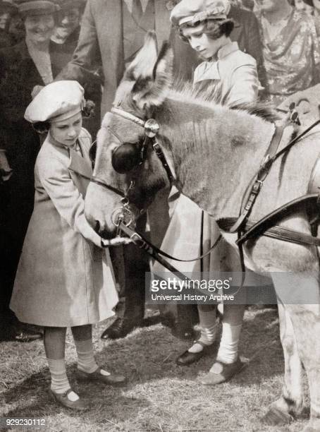 Princess Margaret, left, and Princess Elizabeth, future Queen Elizabeth II, right, at the Royal Agricultural Show in 1939. Princess Margaret,...