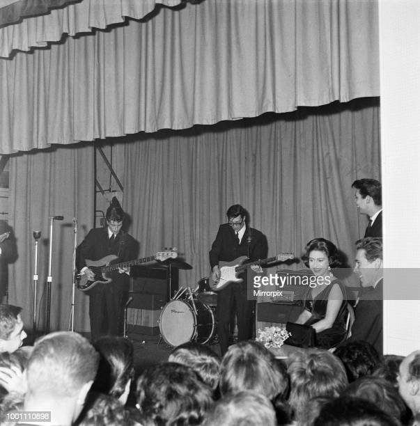 Princess Margaret, Lord Snowdon and Cliff Richard listening to two of the Shadows at Club 59, Eton College Mission, Hackney Wick, 22nd March 1962.