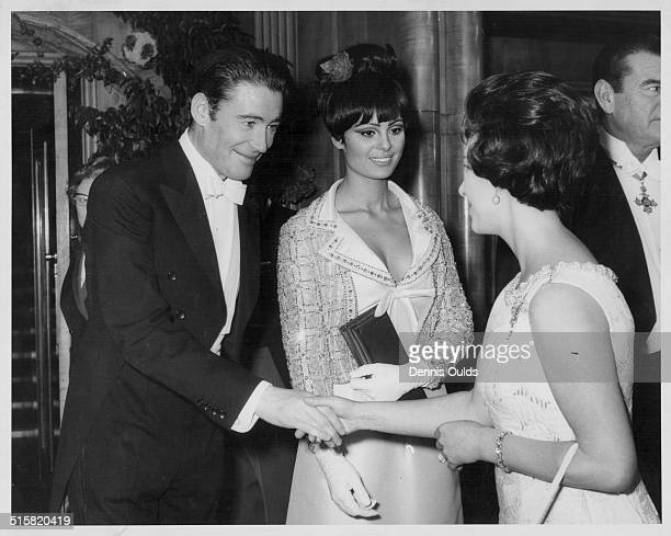 Princess Margaret meeting actors Peter O'Toole and Daliah Lavi stars of the film 'Lord Jim' attending the Royal Film Performance at Odeon Leicester...