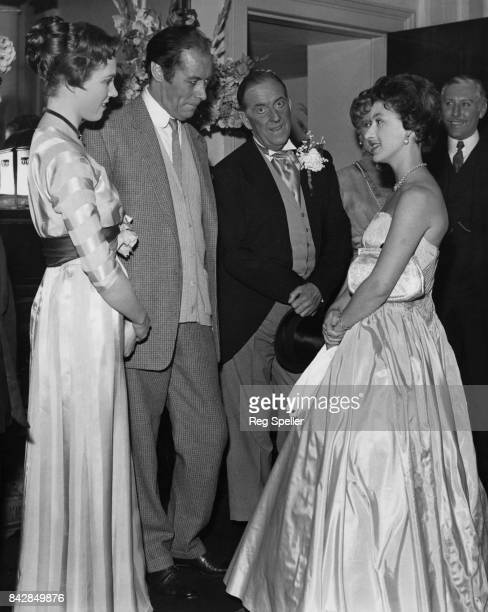 Princess Margaret meets actors Julie Andrews Rex Harrison and Stanley Holloway in the Royal Box at the Theatre Royal on Drury Lane London after a...
