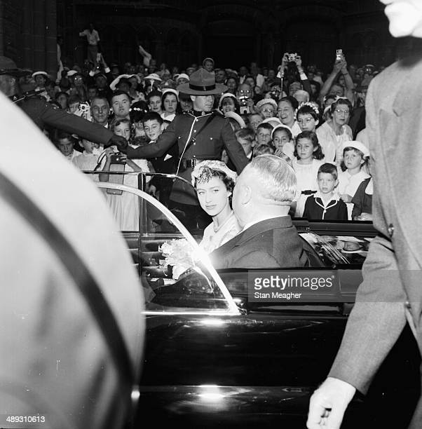 Princess Margaret passing crowds in her car in a visit to Christ Church Cathedral during an official Royal visit to Canada July 13th 1958