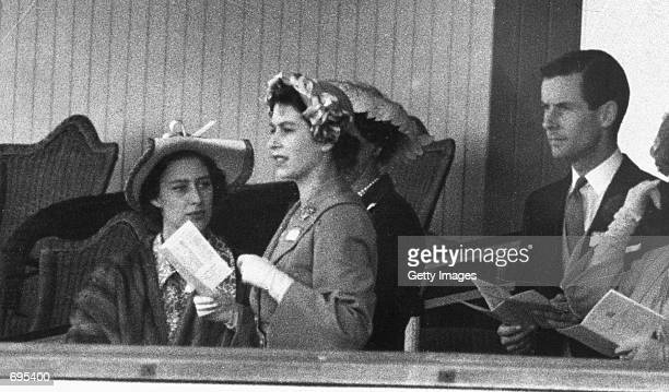 Princess Margaret Princess Elizabeth and Group Captain Peter Townsend gather June 13 1951 in the Royal Box at Ascot In 1955 Princess Margaret was...