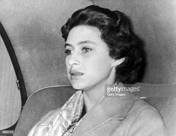 Princess Margaret returns to Clarence House October 17 1955 after a weekend in the country where Group Captain Peter Townsend was also a guest The...
