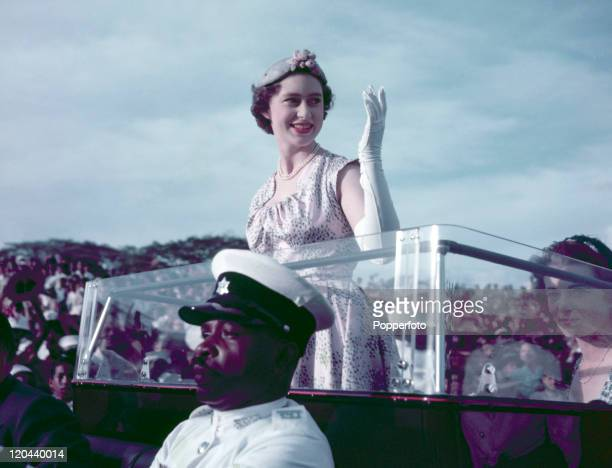 Princess Margaret rides in an opentop limousine and greets wellwishers in Port of Spain during her Royal Tour of Trinidad and Tobago circa February...