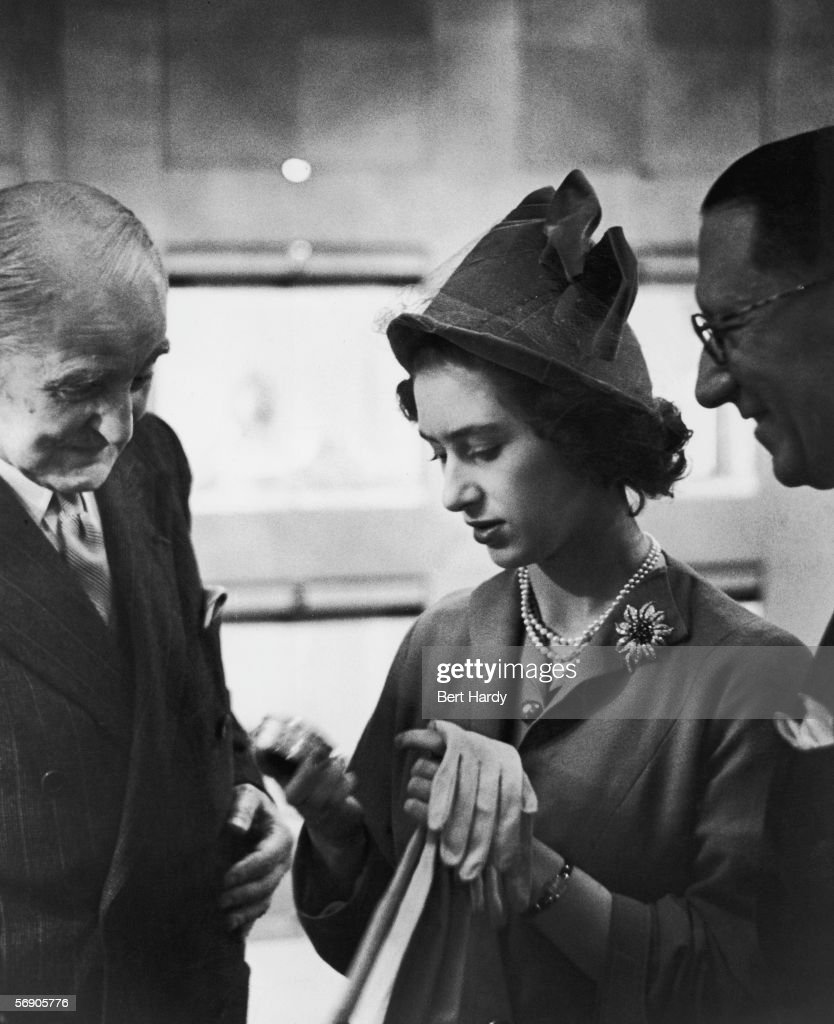Princess Margaret Rose (1930 - 2002) attends an exhibition of work by Russian jeweller Peter Carl Faberge at Wartski on Regent Street, December 1949. Here she examines a small box, watched by Eugene Faberge, son of the creator of the piece. Original Publication : Princess Margaret At The Jewellers - pub. 1949