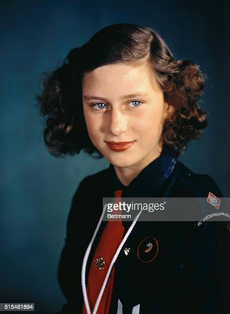 Princess Margaret Rose wears a uniform of the Girl Guides, an organization in which she is very active, in this photo. The princess will be fourteen...