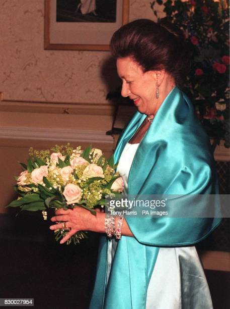 Princess Margaret smiles after being presented with a bouquet of pink roses at the Gala Performance of the English National Ballet's presentation of...