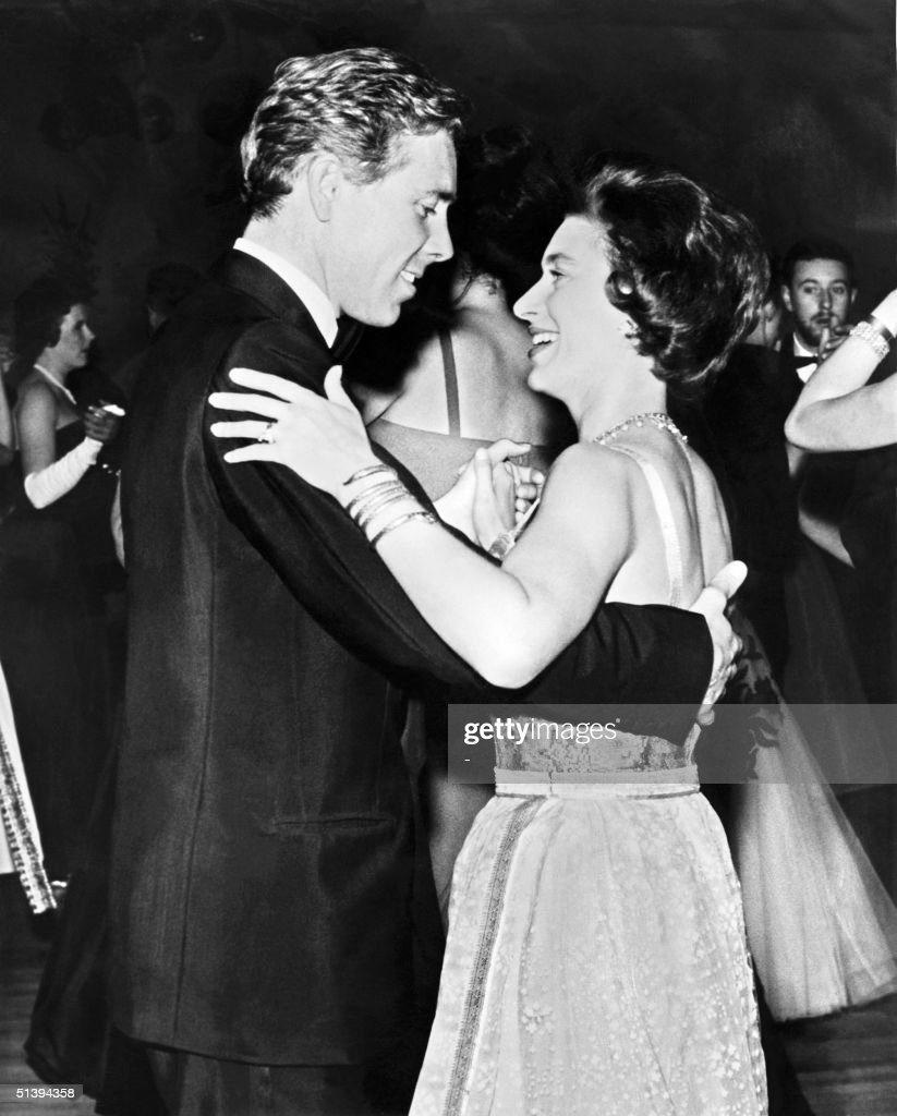 Princess Margaret, the younger sister of Britain's Queen Elizabeth II, dances 16 October 1963 with her husband Antony Armstrong-Jones, Earl of Snowdon at the West London Hilton Hotel during a charity ball. Princess Margaret and the Earl of Snowdon had two children, son Linley and daughter Sarah, but announced their separation in March 1976. When the marriage was officially ended two years later, Margaret became the first royal to divorce since Henry VIII in the 16th century.