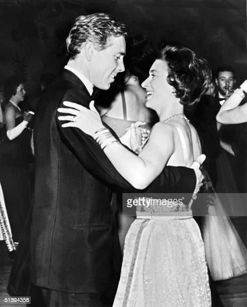 Princess Margaret the younger sister of Britain's Queen Elizabeth II dances 16 October 1963 with her husband Antony ArmstrongJones Earl of Snowdon at...
