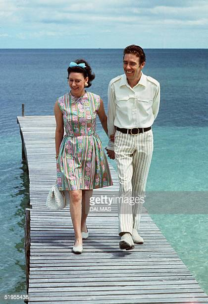 Princess Margaret the younger sister of Britain's Queen Elizabeth II walks 14 March 1967 with her husband Earl of Snowdon on a pontoon in the Bahamas...