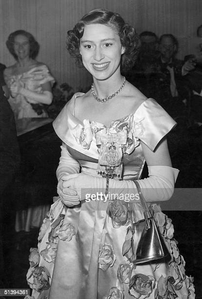 Princess Margaret the younger sister of future Britain's Queen Elizabeth II smiles 06 June 1951 at the ball given by the Victoria League at...