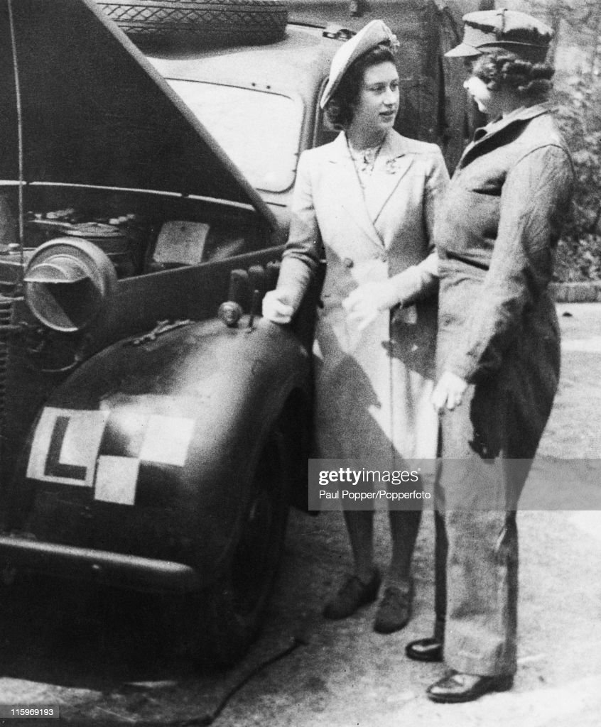 Princess Margaret visits her sister Princess Elizabeth, who is training to qualify as an ATS mechanic at a training centre in southern England, April 1945. At this stage she is a Second Subaltern of the ATS (Auxiliary Territorial Service).