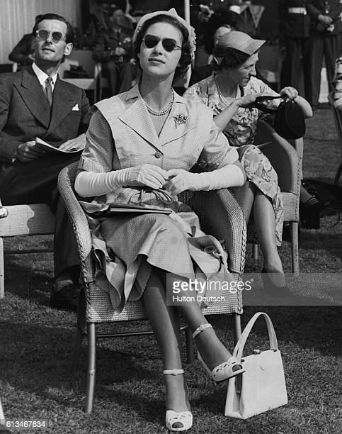 Princess Margaret watches a Royal Air Force display at Farnborough which was also attended by her parents the King and Queen