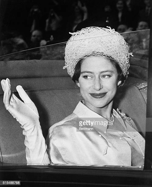 Princess Margaret waves from her coach at Buckingham Palace here May 6th as she leaves on her honeymoon with Antony Armstrong-Jones.
